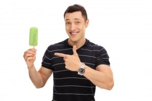 Man using popsicle to ease Invisalign discomfort in Bustleton